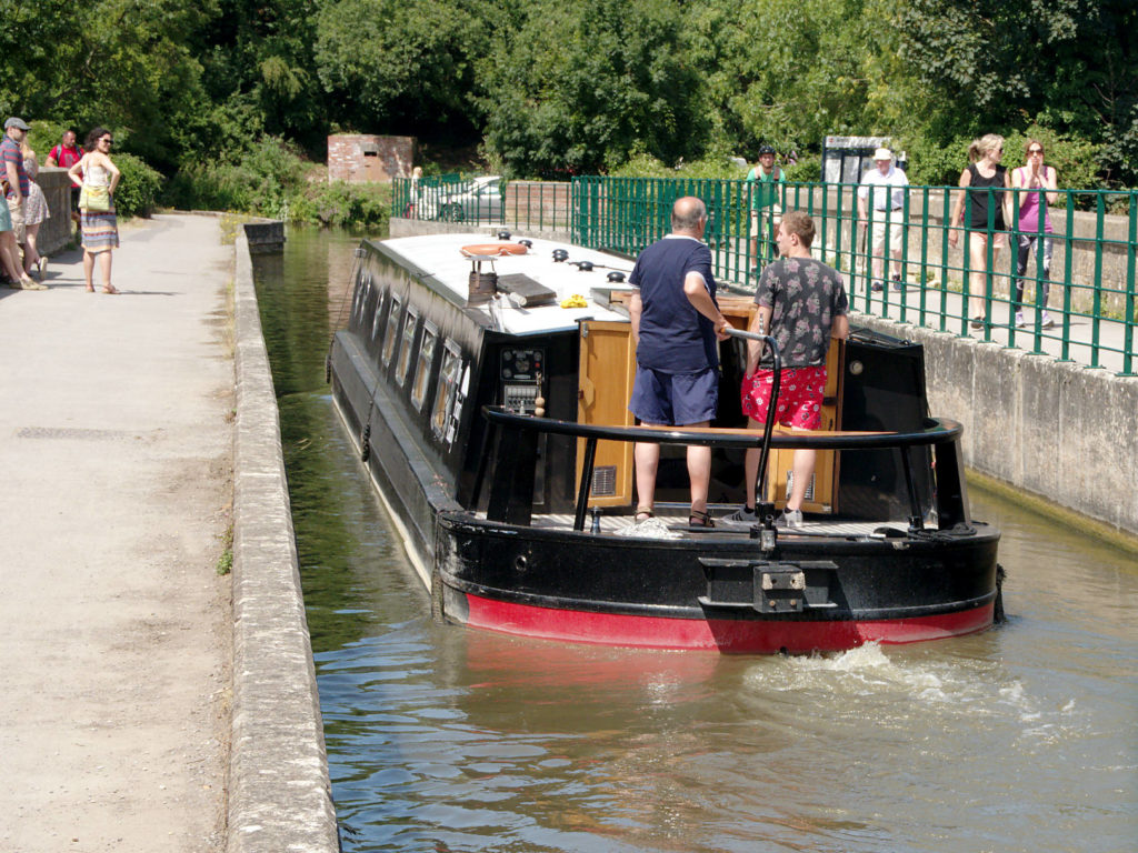 A barge crossing the Avoncliff Aqueduct